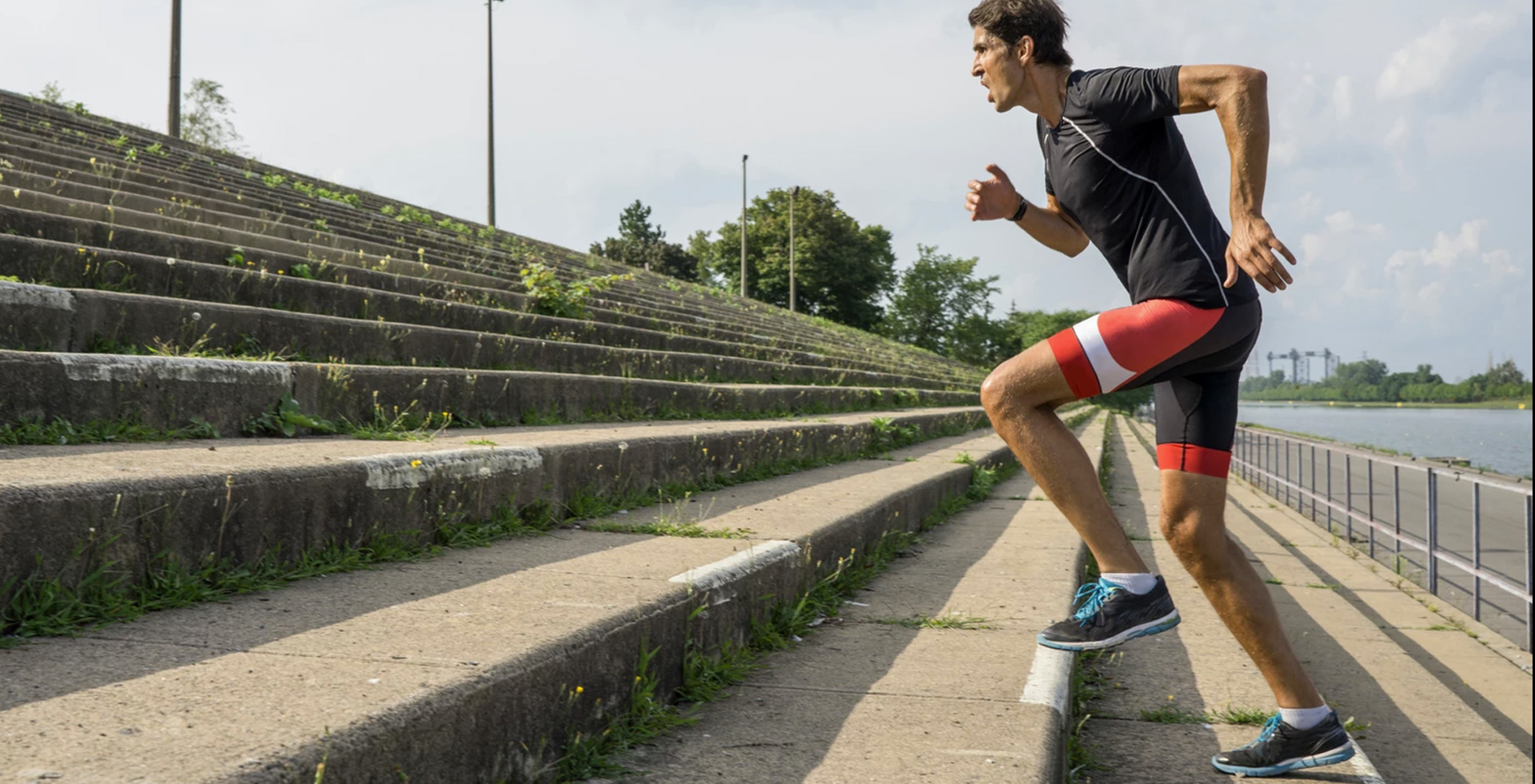 Man running up stairs working out