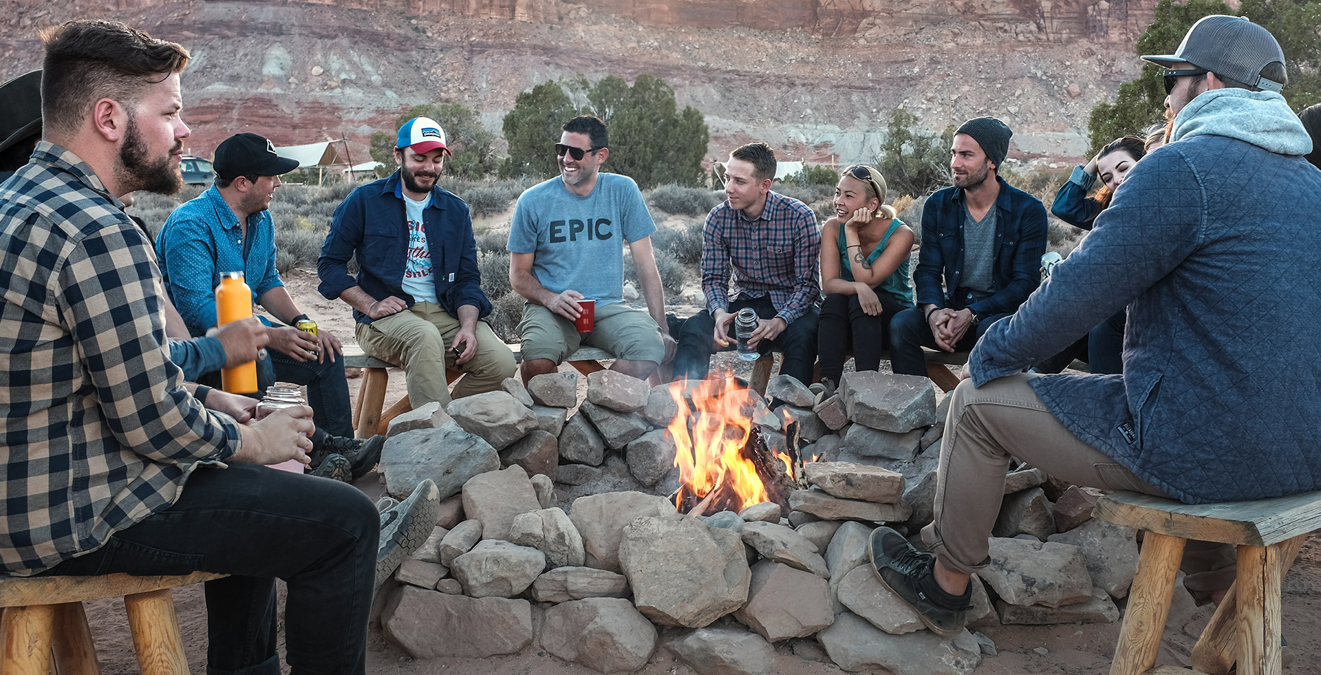 Group of people around a campfire socializing